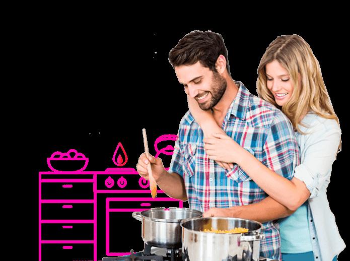 Pareja cocinando en cocina de gas